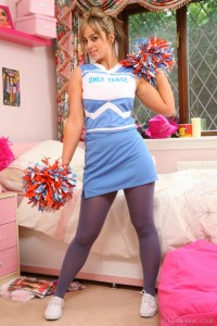 Cute Cheerleader in Pantyhose with her PomPoms