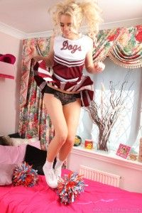 Cheerleader Flyskirt While Jumping on her Bed