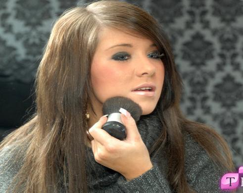 Classy Brunette Doing her Blusher