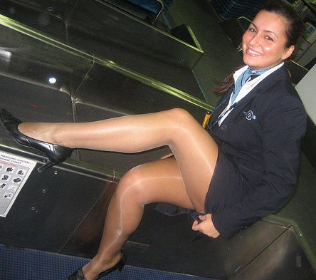 Cutie Smiling Leggy Air Hostess
