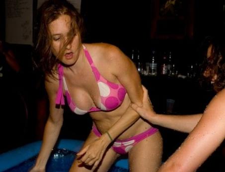 Sexy oiled bikini wrestling