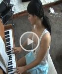 VIDEO: Elise is Playing the Piano – Downblouse Time!
