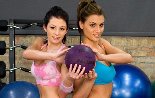 Two Sexy Fit Girls in the Gym maintaining their Hot Bodies