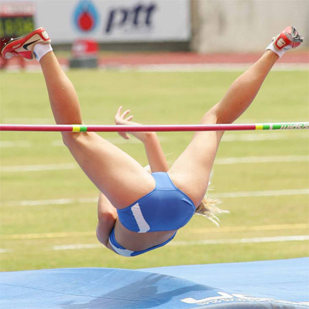 her legs as she prepares to land from her high jump (crotch shot