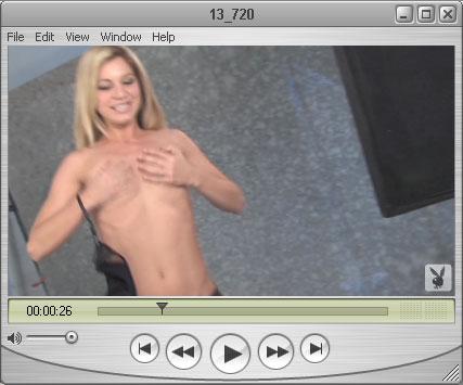 Blond Jennifer puts on a Hand Bra