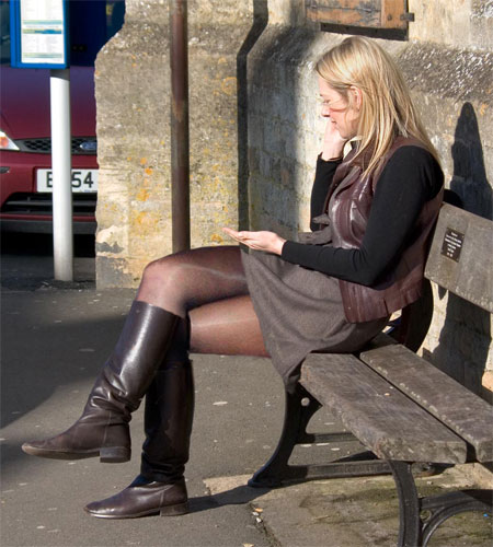 Candid Blonde in Pantyhose and Boots on a Bench