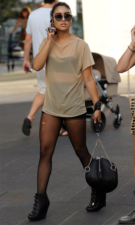 Girl with Ripped Pantyhose in the Street