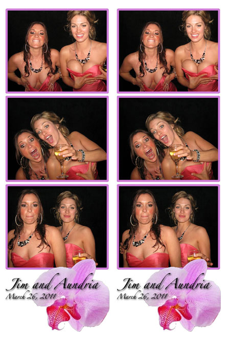Two girls putting their hands on their boobs in a wedding photobooth