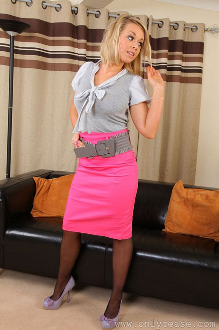 Melissa Debling in a Pink Skirt and Stockings