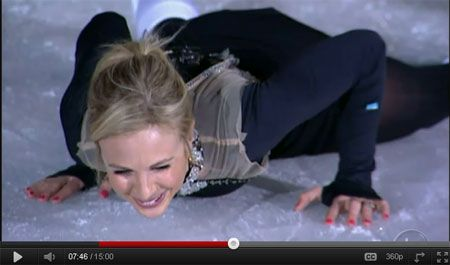 Elisabeth Laughs as she falls flat on the ice