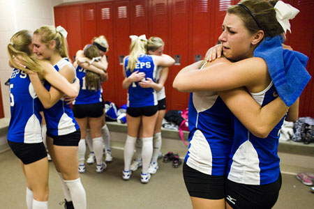 Hugging Volleyball Players in the Locker Room