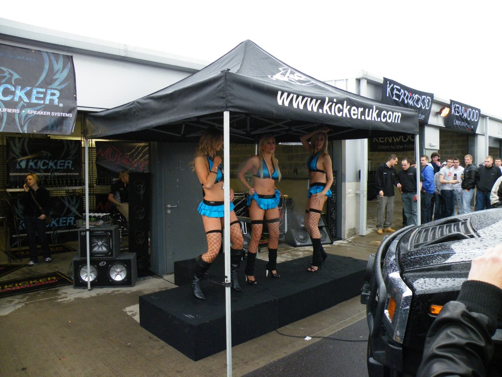 Three Blondes Dancing at a Car Show