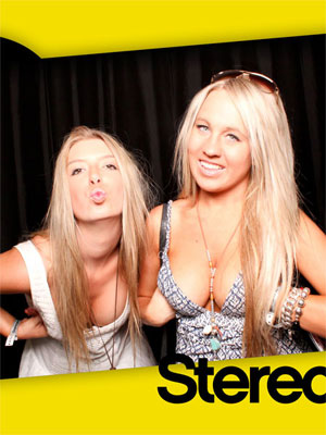 Blondes Showing Cleavage in a Photobooth