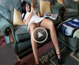 Charley Upskirted as she Reads on the Sofa