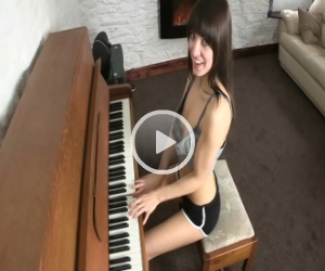 Sammy Shows Downblouse as she Plays the Piano