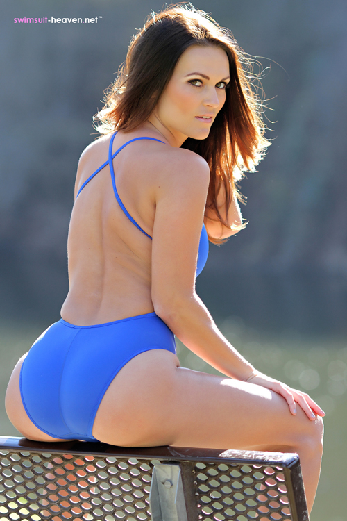 Morgan has her legs apart in her blue Speedo swimsuit on Swimsuit Heaven