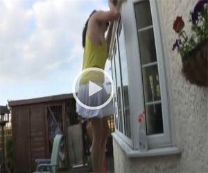 Upskirted as she cleans the window