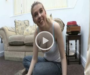 Holly shows Downblouse as she Strokes a Puppy