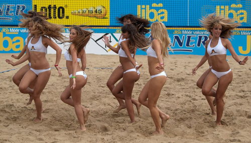Hot Cheerleaders Dancing on the Sand in Tight White Bikinis