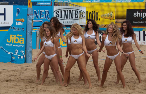 Volleyball Cheerleaders Dancing on the Sand