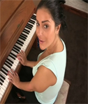 Keira Jones is Playing the Piano on DownblouseLoving