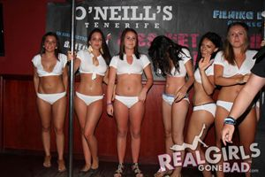 A group of cute British girls in a wet t-shirt contest in O'Neill's bar