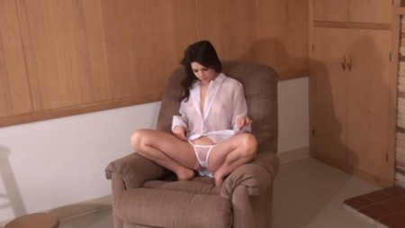 Kristy is teasing on the sofa in sheer white panties