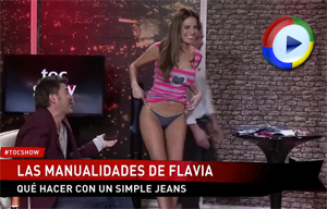 Girl lifts up her skirt on live television and shows the camera her cute cameltoe panties