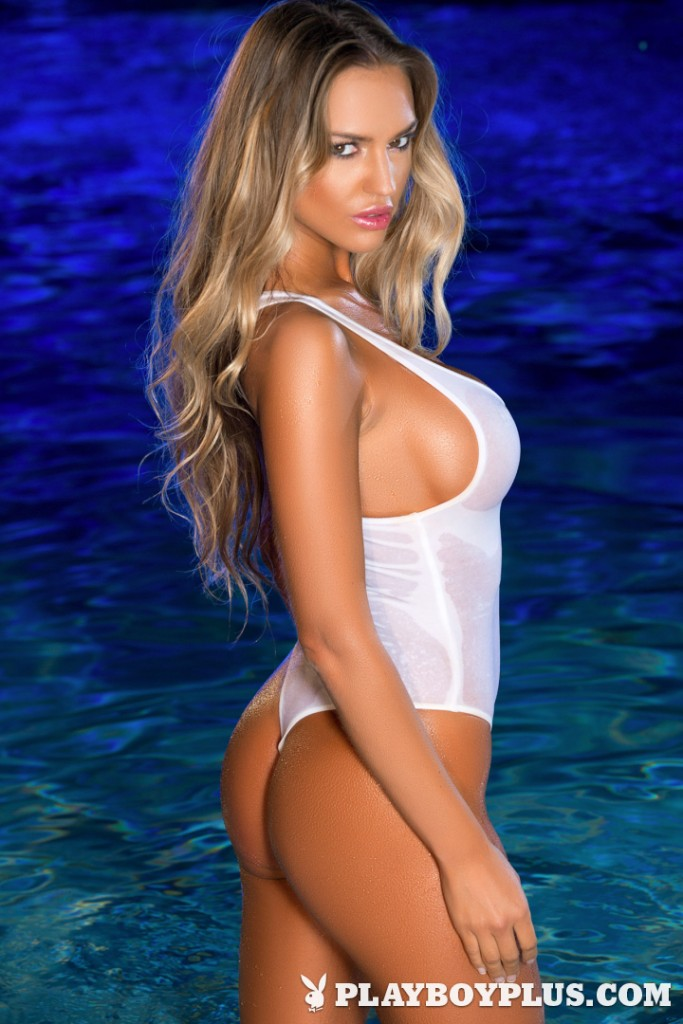 Charlie Riina posing in a white swimsuit