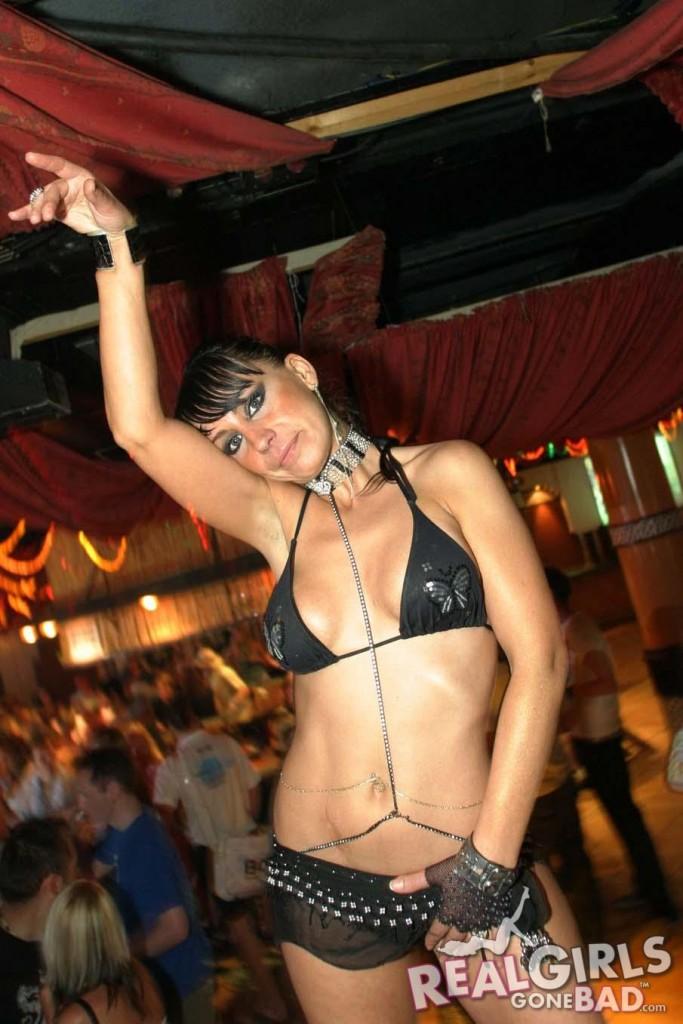 Real girl dancing on stage in a bikini