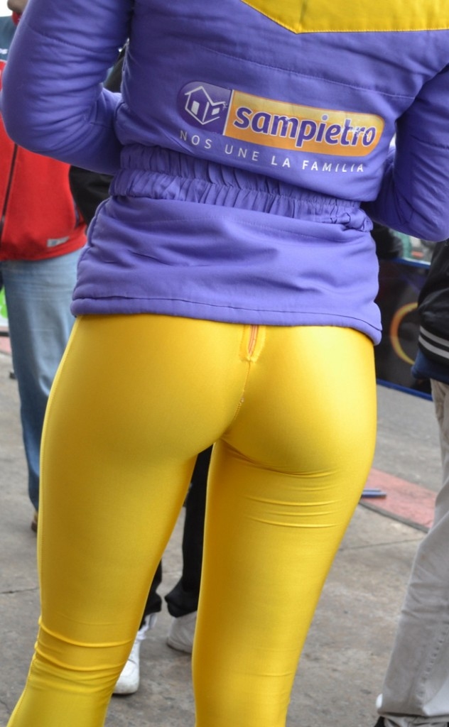 Girl in tight yellow leggings showing off her cute ass