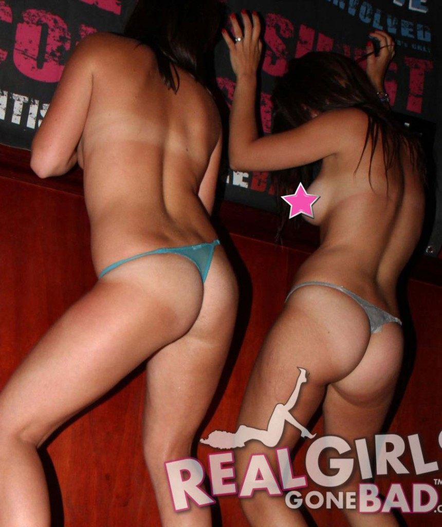 Girls wearing just panties shake their asses for the crowd