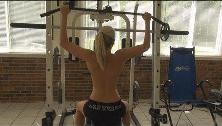 Holly works out topless in the gym