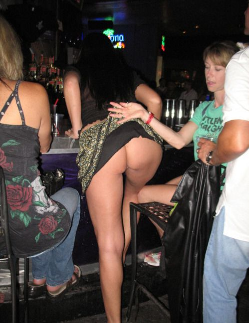 Girl has her skirt lifted, shows her hot ass