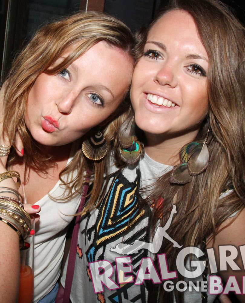 Two brunette party girls having a top night out