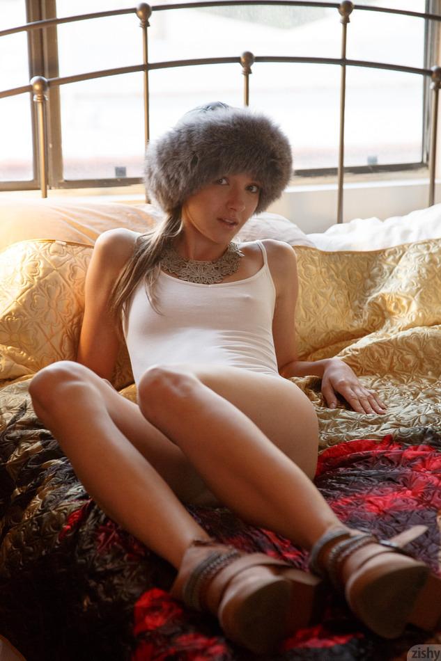 Maria Turova posing in a white leotard for Zishy (with pokies on display)
