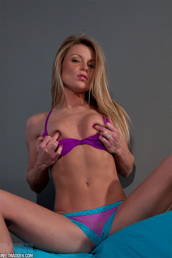 Meet Madden covers her nipples with just her fingers