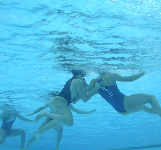 Water polo girls pulling each others swimsuits