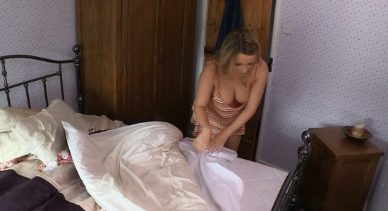 Penny shows nice cleavage as she makes the bed