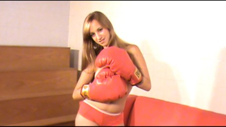 Noelia gets topless and puts on some huge boxing gloves