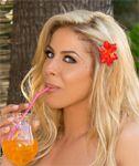 Singer Jillisa Lynn poses in her bikini for a Tropical Princess photoshoot and video