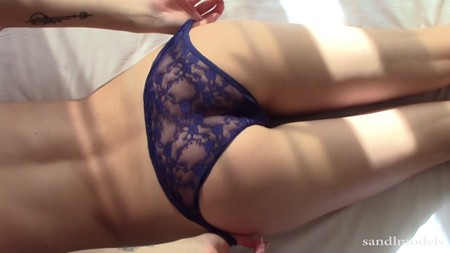 Arina pulls her sexy sheer panties as she lies on the bed for Sandlmodels
