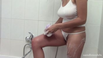 Raquel takes a shower in her white thong