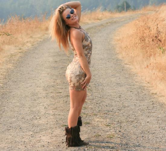 Cute blonde girl outdoors in a hot dress