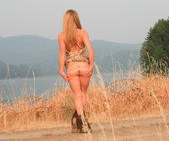 Girl pulls her panties down outdoors