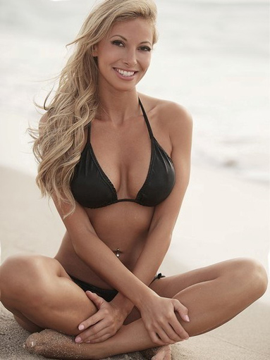 Blonde beauty in a bikini on the beach