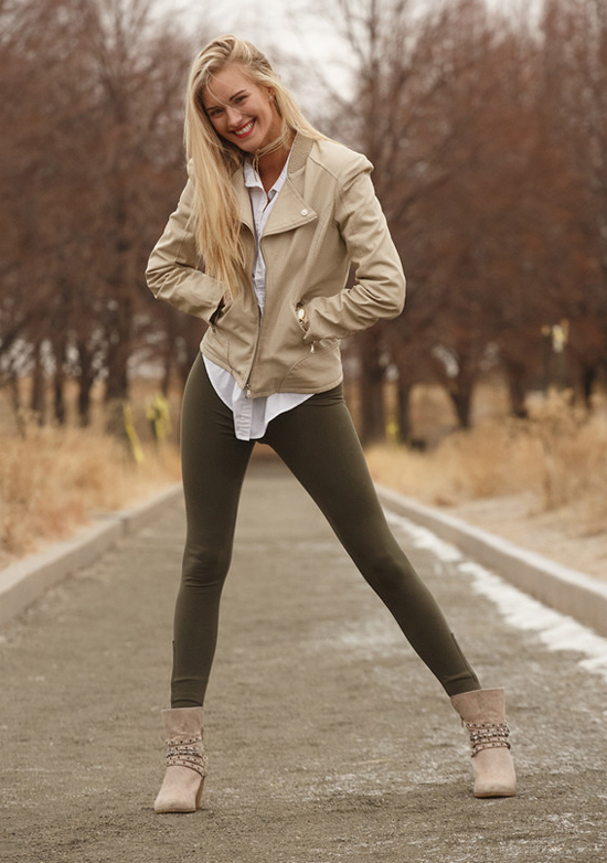 Blonde girl in leggings smiling on a cold day