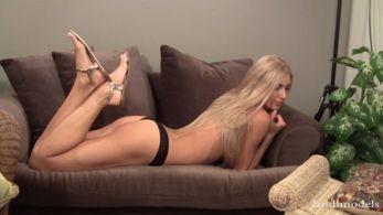 Lying topless on the sofa