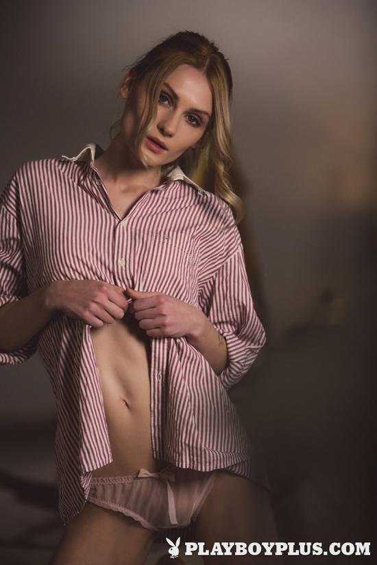 Blonde Celia slowly strips