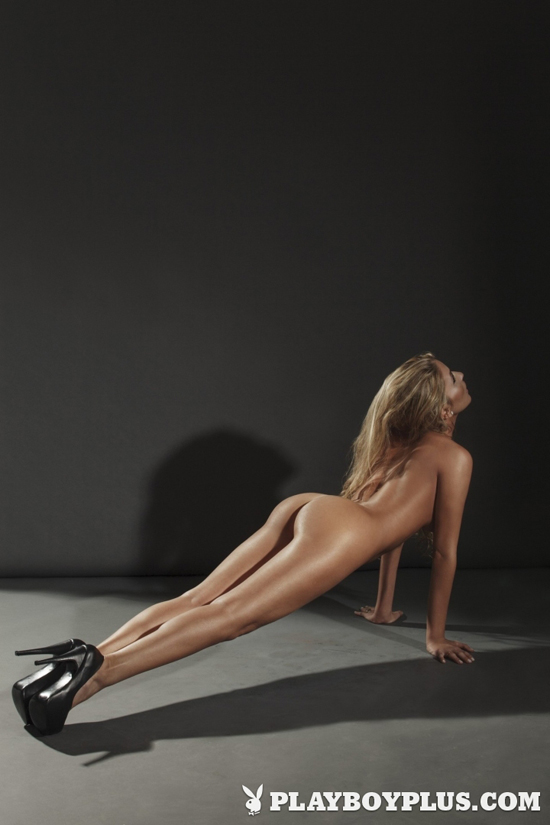 Fit girl nude doing press-ups